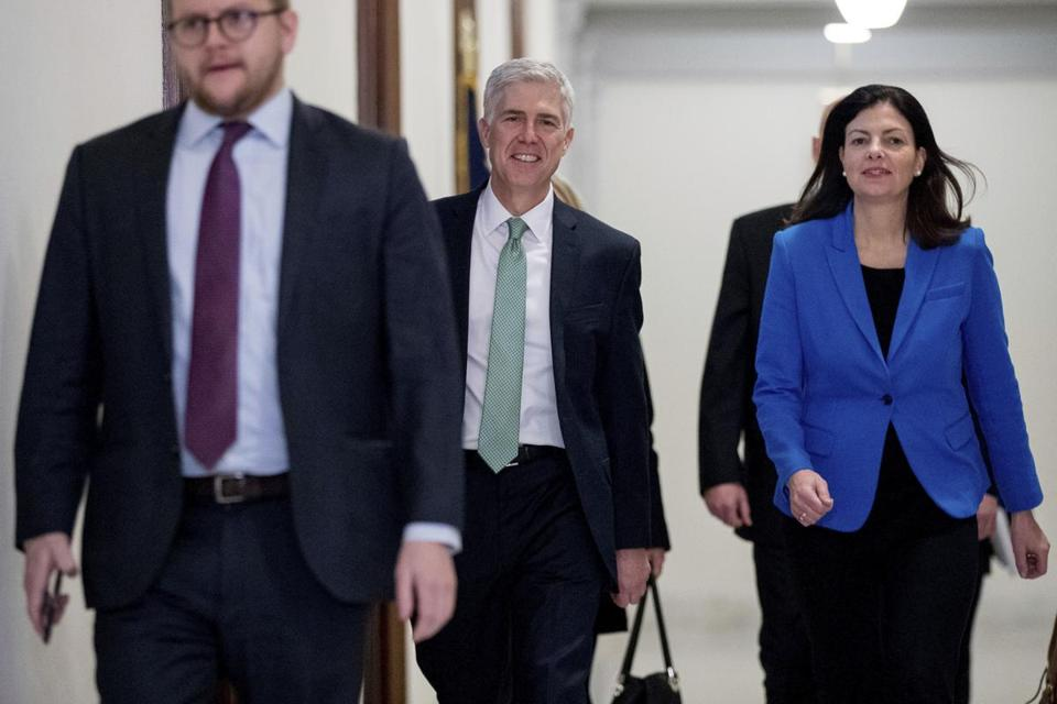 Supreme Court Justice nominee Neil Gorsuch, center, accompanied by former New Hampshire Senator Kelly Ayotte.