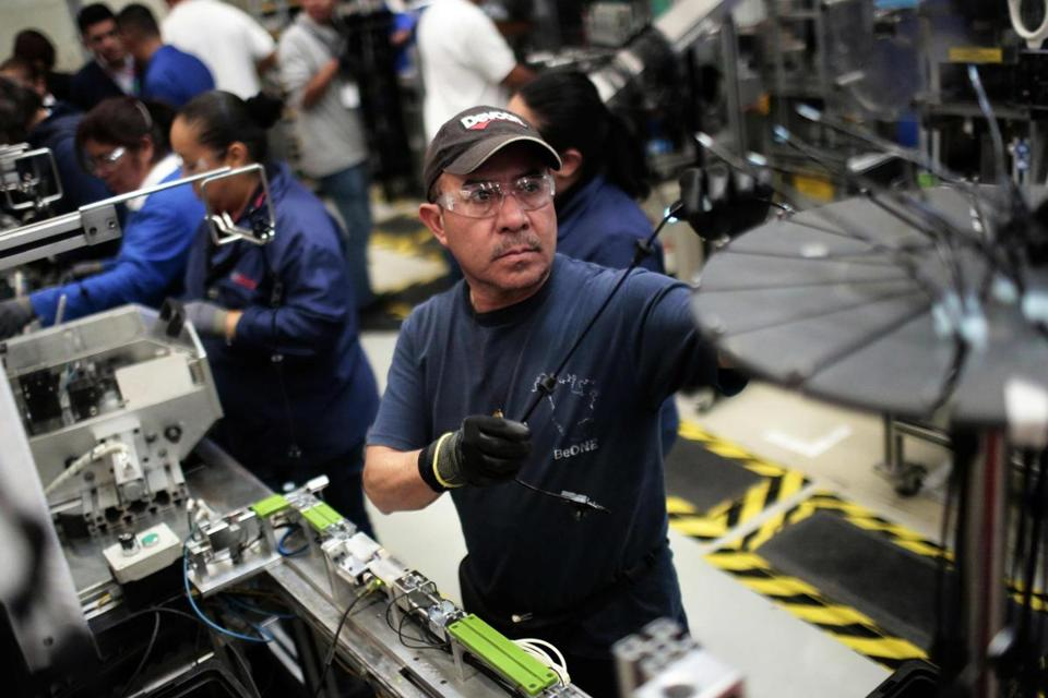 At work in the auto parts production line in the Bosch factory in San Luis Potosi, Mexico, on January 11, 2017. US President Donald Trump has threatened to impose a 35 percent import tariff on companies that ship jobs to Mexico. / AFP PHOTO / PEDRO PARDOPEDRO PARDO/AFP/Getty Images