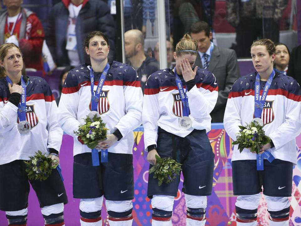 FILE -- U.S. players react to their silver-medal finish in the women's hockey final, at the Winter Olympics in Sochi, Russia, Feb. 20, 2014. Members of the United States women's team announced that they would sit out the 2017 World Championships after negotiations for an increase in wages and support from USA Hockey stalled. (Doug Mills/The New York TImes)
