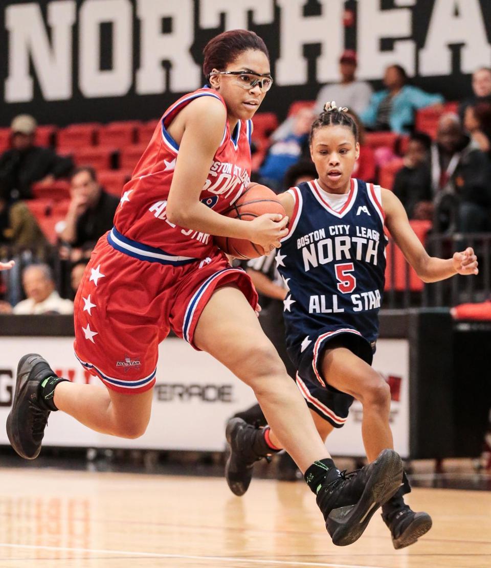 03/25/2017 BOSTON, MA Team Red's Janyah Gulley (cq) 8, dribbled past Team Blue's Taneja Jones-Drayton (cq) 5, during the Boston City League Basketball 2017 All-Star games held at NU's Cabot Center in Boston. (Aram Boghosian for The Boston Globe)