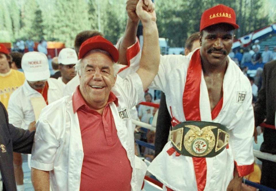 Lou Duva (left) with heavyweight champion Evander Holyfield in 1989.