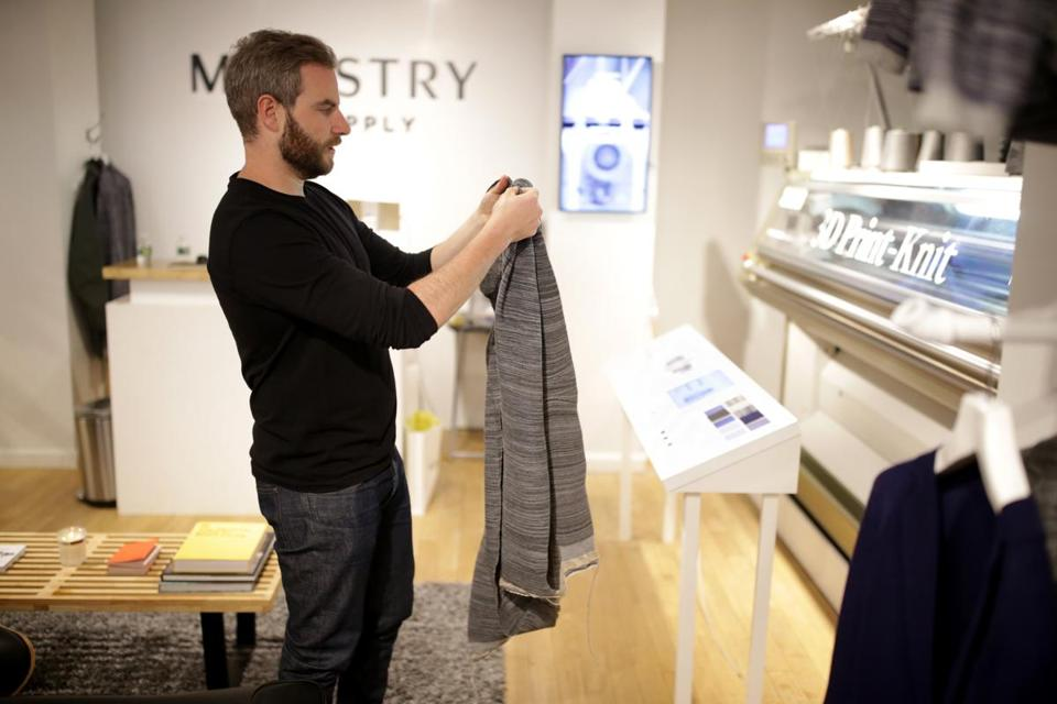 Brian Kennedy of Ministry of Supply inspected a sweater made on the 3D Print-Knit machine.