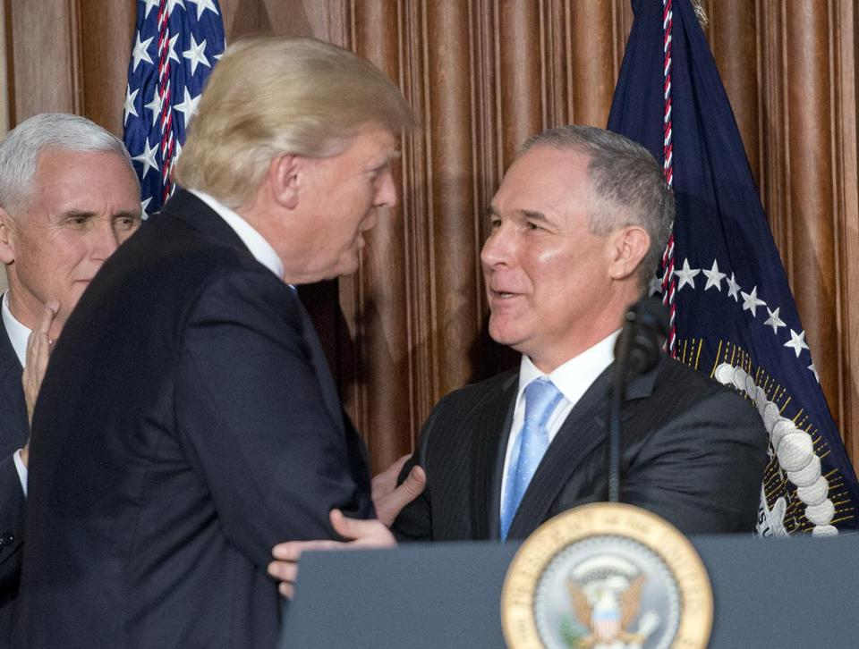 President Donald Trump (left) greeted US Environmental Protection Agency Administrator Scott Pruitt (right) Tuesday at EPA headquarters.