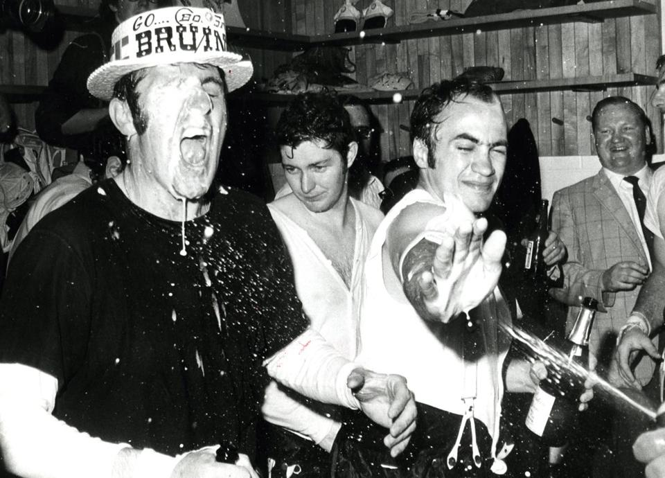 Gary Doak (right) celebrates the Bruins' Stanley Cup championship in 1970 with teammates Phil Esposito and Fred Stanfield.