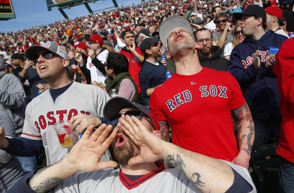 From left to right,  Tim Gagne, TJ Gregson and Lareto Guglietta reacted as the Red Sox score against the Pirates during the fifth inning of play on Opening Day at Fenway Park.