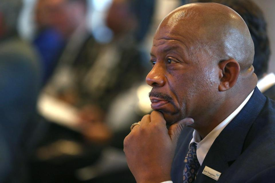 J. Keith Motley will step down as UMass Boston's chancellor at the end of the academic year .
