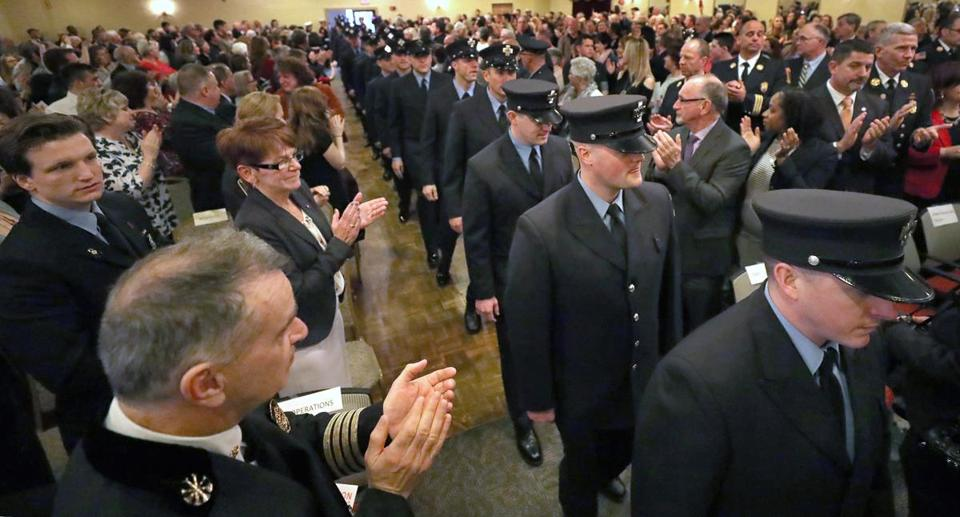 BOSTON, MA - 4/05/2017: A round of applause on their arrival....Approx 49 firefighters were sworn in after graduating from the Boston Firefighting Academy in Florian Hall. (David L Ryan/Globe Staff Photo) SECTION: METRO TOPIC06firegrad