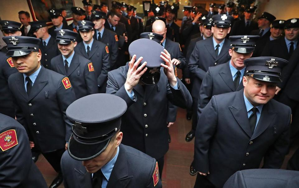 BOSTON, MA - 4/05/2017:Last minute hat checks one being done by Dan Mahoney Boston Fire.... Approx 49 firefighters were sworn in after graduating from the Boston Firefighting Academy in Florian Hall. (David L Ryan/Globe Staff Photo) SECTION: METRO TOPIC06firegrad