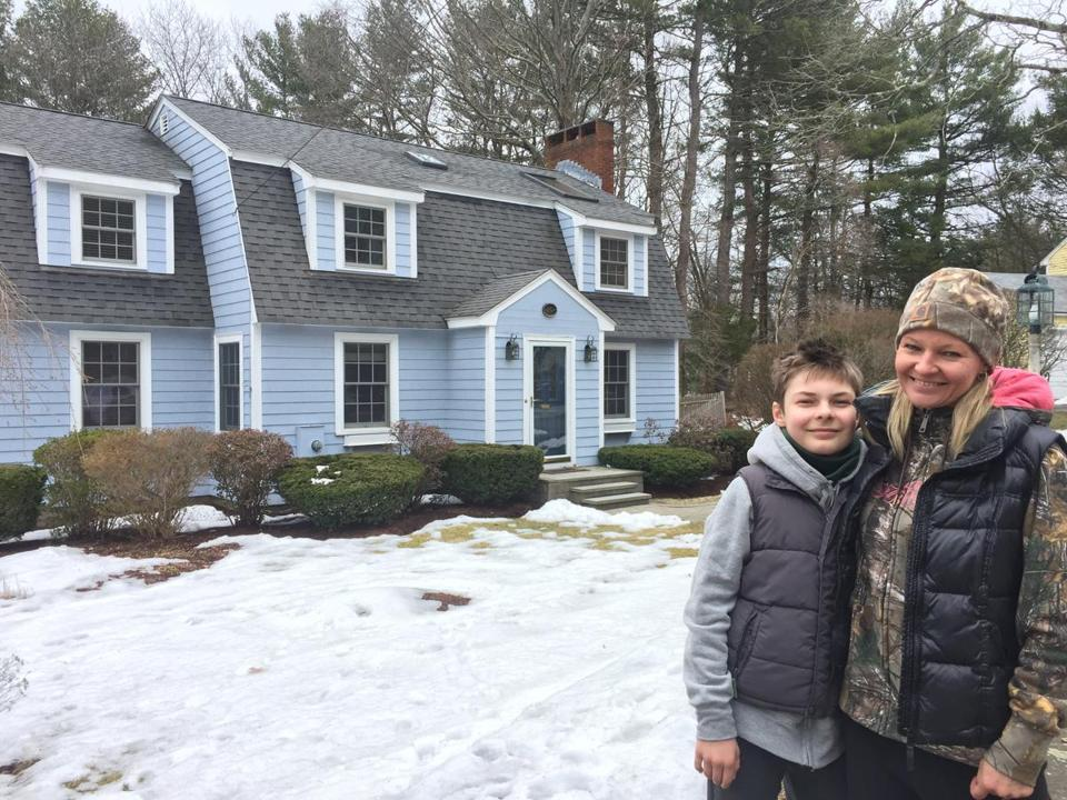 Sabine Witek, 46, marketing professional, at open house in Wellesley in March (with her son)by Molly Williams