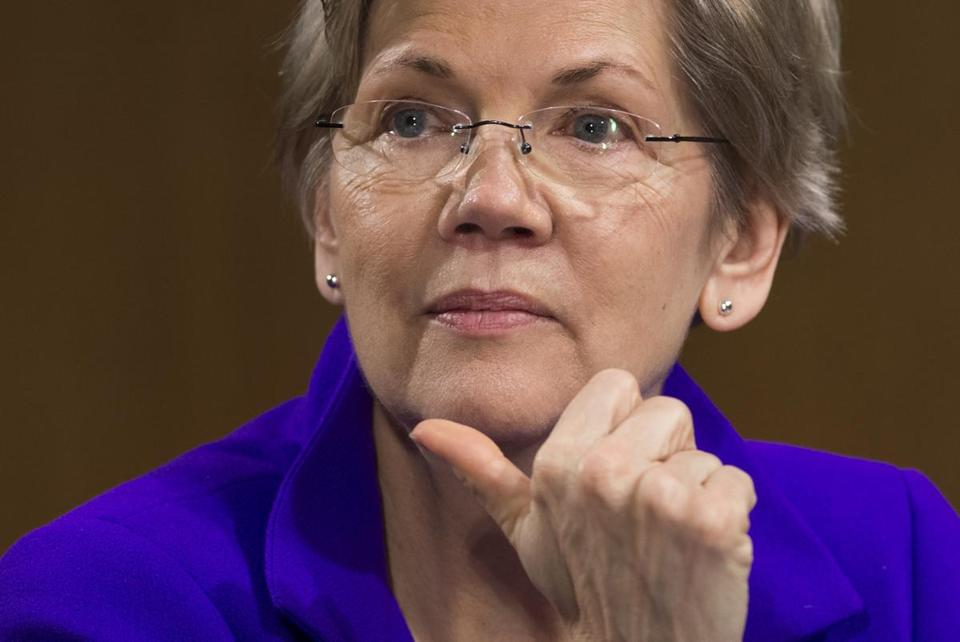 "(FILES) This file photo taken on February 24, 2015 shows US Senator Elizabeth Warren(D-MA), as she attends a US Senate Banking, Housing and Urban Affairs Committee hearing on Capitol Hill in Washington, DC. Donald Trump has dominated the Twitter battle for the White House by insulting and belittling his rivals, but he has found a formidable social media opponent in the fiery senator and potential Democratic vice presidential pick Elizabeth Warren. While Hillary Clinton prefers to ignore the attacks of her Republican adversary Trump, who blasts the former secretary of state as ""crooked,"" Warren has no qualms about wading into the fray. / AFP PHOTO / SAUL LOEBSAUL LOEB/AFP/Getty Images"