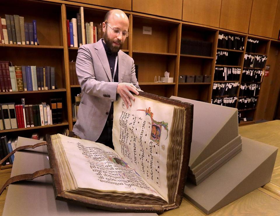 Jay Moschella, curator of rare books, showed off a 1495 book of psalms made for an Italian monastery.