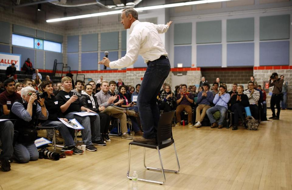 Former Maryland Governor Martin O'Malley balanced on a chair during a town hall campaign stop at Grinnell College in Grinnell, Iowa in 2016.
