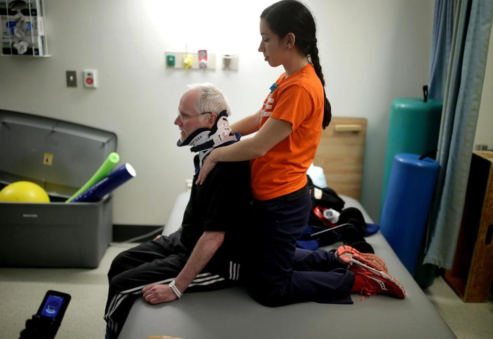 For Chris Hoeh, paralyzed in a skiing accident, physical therapy is a regular part of life. Therapist Mellissa Agriman-akis treated him at a recent Spaulding Hospital session.