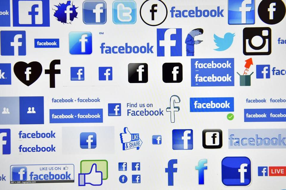 "(FILES) This file photo taken on December 28, 2016 shows logos of US online social media and social networking service Facebook in Vertou, France. Facebook on April 6, 2017 ramped up its fight against ""fake news"" by adding tips on how to tell when shared stories are bogus. An initiative being launched in the US, France and a dozen other countries added an educational tool in an ""awareness display"" in news feeds at the leading online social network. / AFP PHOTO / LOIC VENANCELOIC VENANCE/AFP/Getty Images"