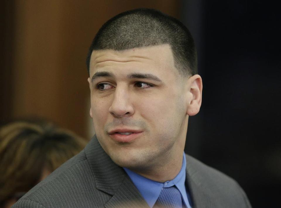 Former New England Patriots tight end Aaron Hernandez turned to look toward his fiancee Shayanna Jenkins Hernandez as he reacted to his double murder acquittal.