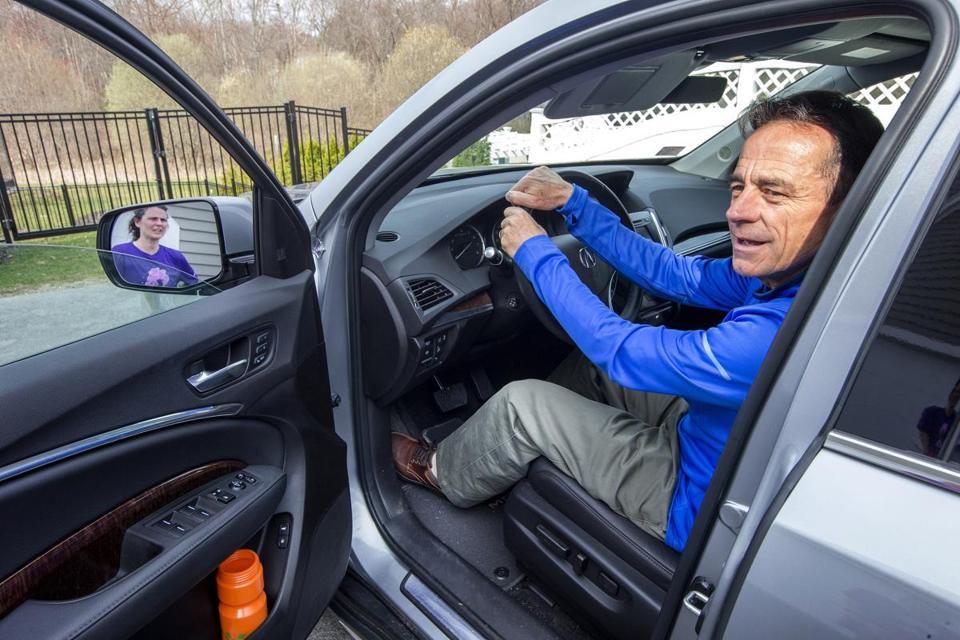 Boston, Mass-April 12, 2017, Stan Grossfeld/Globe Staff- Boston Marathon race director Dave McGillivray leaves his North Andover home for a meeting with the Mayor at City Hall. He says goodbye to his wife Katie.