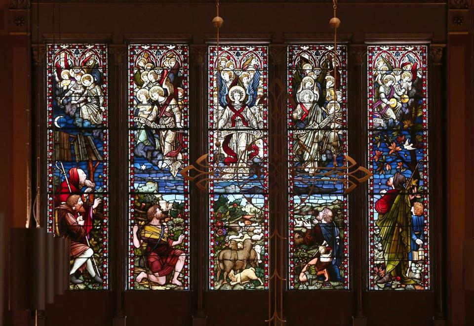 Five panels of stained-glass at Old South Church depict angels comforting shepherds in Bethlehem.