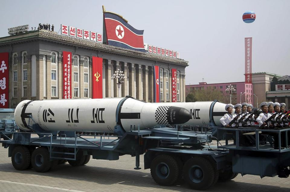 In this Saturday, April 15, 2017, file photo, a submarine missile is paraded across Kim Il Sung Square during a military parade in Pyongyang, North Korea to celebrate the 105th birth anniversary of Kim Il Sung, the country's late founder and grandfather of current ruler Kim Jong Un. North Korea's big day, the anniversary of the birth of its founding leader, Kim Il Sung, came and went with no underground nuclear test by the North, and no pre-emptive strikes off the deck of the USS Carl Vinson aircraft carrier sent to waters off the Korean Peninsula by President Donald Trump. Just hours before Vice President Mike Pence began his visit to Seoul on Sunday, Pyongyang fired off a ballistic missile — but it appears to have exploded seconds after it got off the ground. (AP Photo/Wong Maye-E, File)