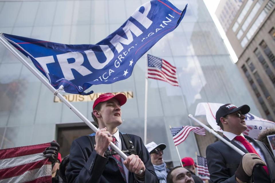 Supporters of President Donald Trump Tristan Pitera, left, and Jesse Michaelson of Sound Beach, N.Y., take part in a March 4 Trump rally on Fifth Avenue near Trump tower, Saturday, March 4, 2017, in New York. (AP Photo/Mary Altaffer)