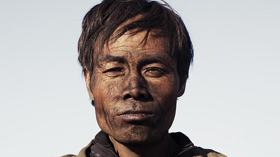 "A worker in a Chinese coal mine from Zhao Liang's ""Behemoth."""