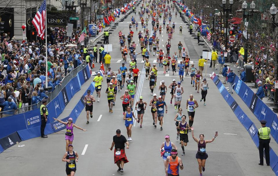 Boston, Massachusetts -- 4/17/2017 - Runners make their way toward the finish line of the 121st Boston Marathon. (Jessica Rinaldi/Globe Staff) Topic: Marathonpics Reporter: