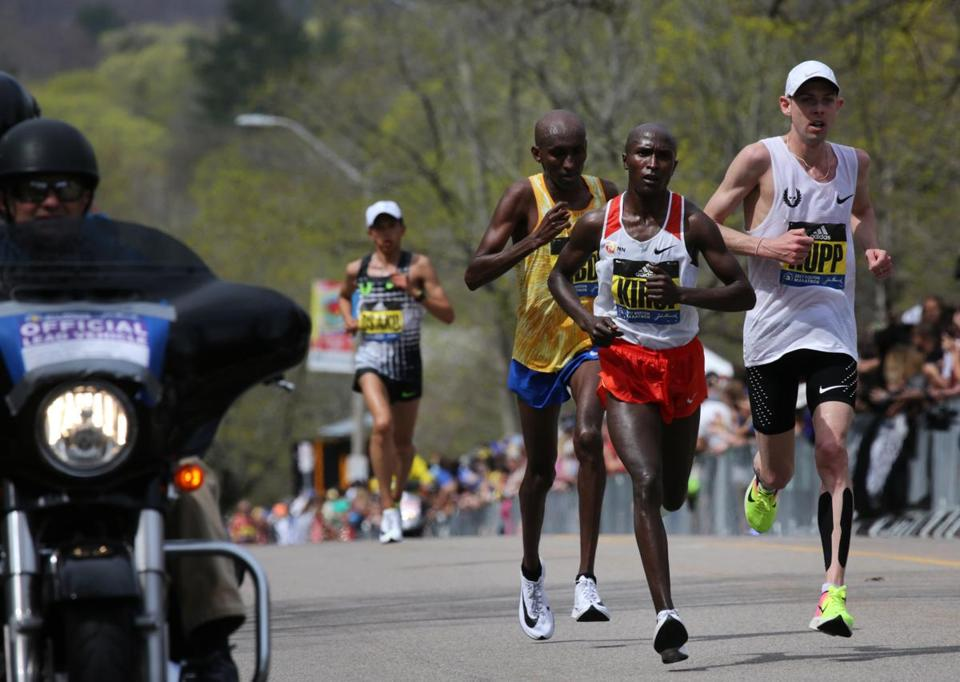 Newton, MA- April 17, 2017: Kenyan Geoffrey Kirui leads the pack up Heartbreak Hill on Commonwealth Avenue in Newton, MA, on April 17, 2017. It is the 121st running of the Boston Marathon, a 26.2-mile journey from Hopkinton to Copley Square. (Globe staff photo / Craig F. Walker) section: metro reporter