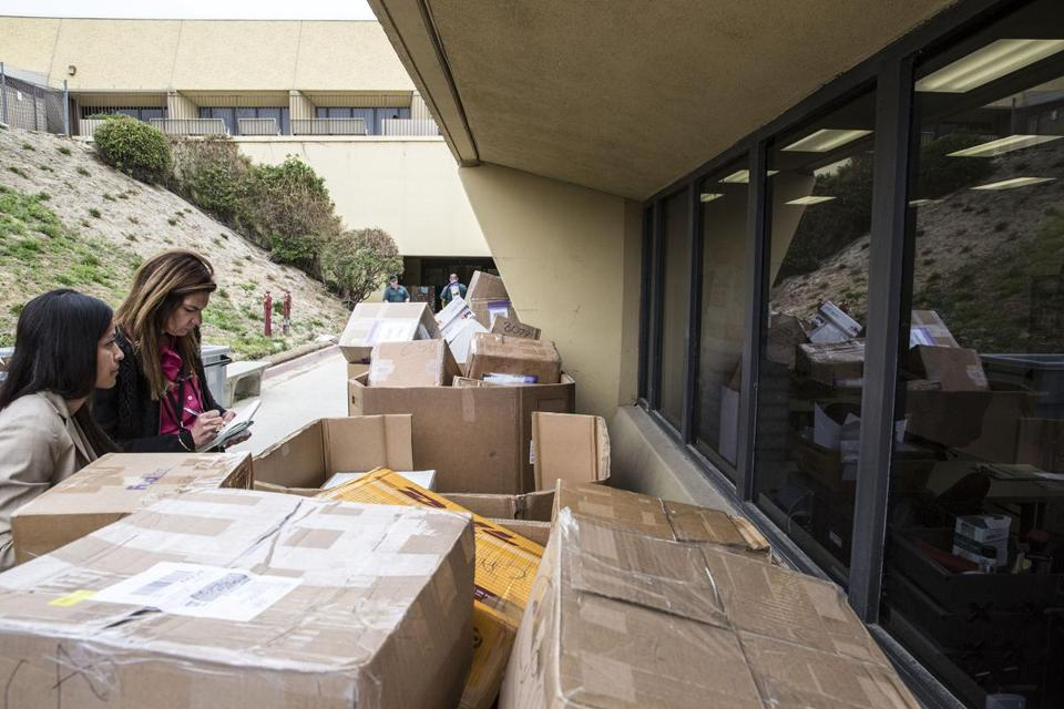 Piles of H-1B visa petitions outside a processing center in Laguna Niguel, Calif.