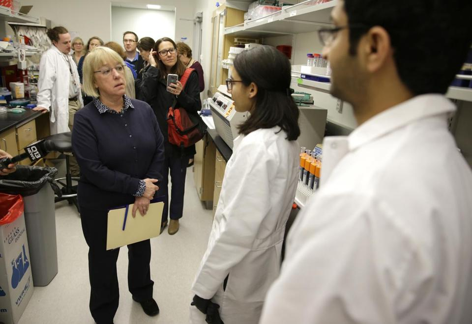 U.S. Sen. Patty Murray, D-Wash., left, talks with researchers Fahd Al Qureshah, right, and Nicole Arroyo, second from right, as she tours an immunology research lab at the University of Washington's UW Medicine South Lake Union Campus Wednesday, April 12, 2017 in Seattle. Murray visited the lab Wednesday to discusses the potential impact to research being done there by President Donald Trump's proposed budget cuts to the National Institute of Health. (AP Photo/Ted S. Warren)