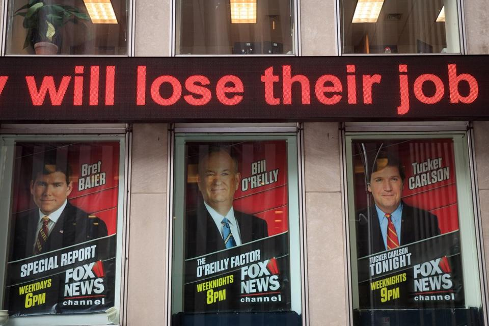 NEW YORK, NY - APRIL 19: Advertisements for Fox News personalities, including Bill O'Reilly, stand in the windows outside of the News Corp. and Fox News headquarters in Midtown Manhattan, April 19, 2017 in New York City. Fox News television personality Bill O'Reilly's future at the network is uncertain following numerous claims of sexual harassment and subsequent legal settlements. (Photo by )