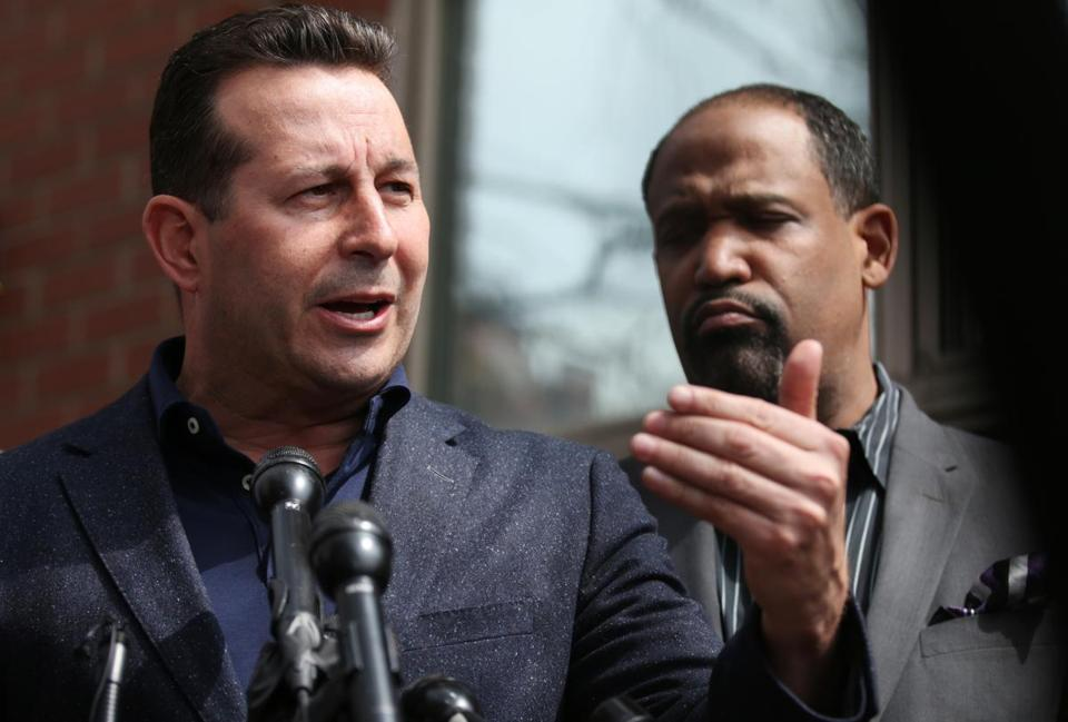 Aaron Hernandez's defense attorneys Jose Baez and Ronald Sullivan held a press conference outside the medical examiner's office in Boston on Friday.