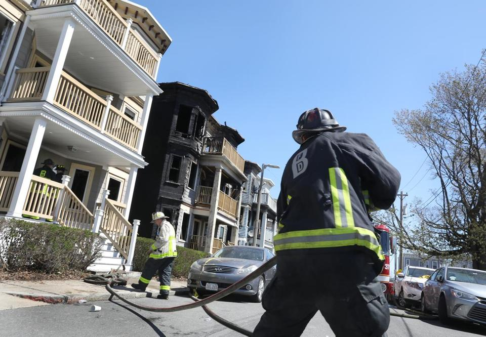 Firefighters worked at the scene of an early-morning six-alarm fire on Marie Street in Dorchester.