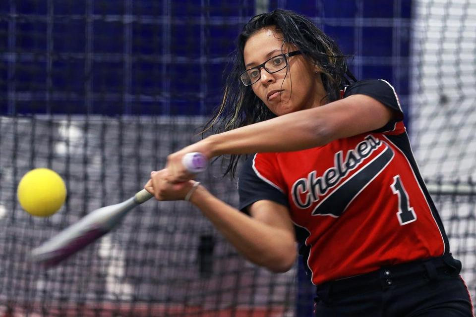 Chelsea, MA April 26, 2017: Chelsea High School softball player Ali Gacharna is pictured as she takes some batting practice in a cage inside a gym at the school. (Globe Staff Photo/Jim Davis)
