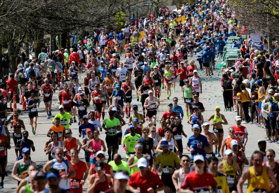 Newton, MA- April 17, 2017: Runners begin their climb up Heartbreak Hill on Commonwealth Avenue in Newton, MA, on April 17, 2017. It is the 121st running of the Boston Marathon, a 26.2-mile journey from Hopkinton to Copley Square. (Globe staff photo / ) section: metro reporter