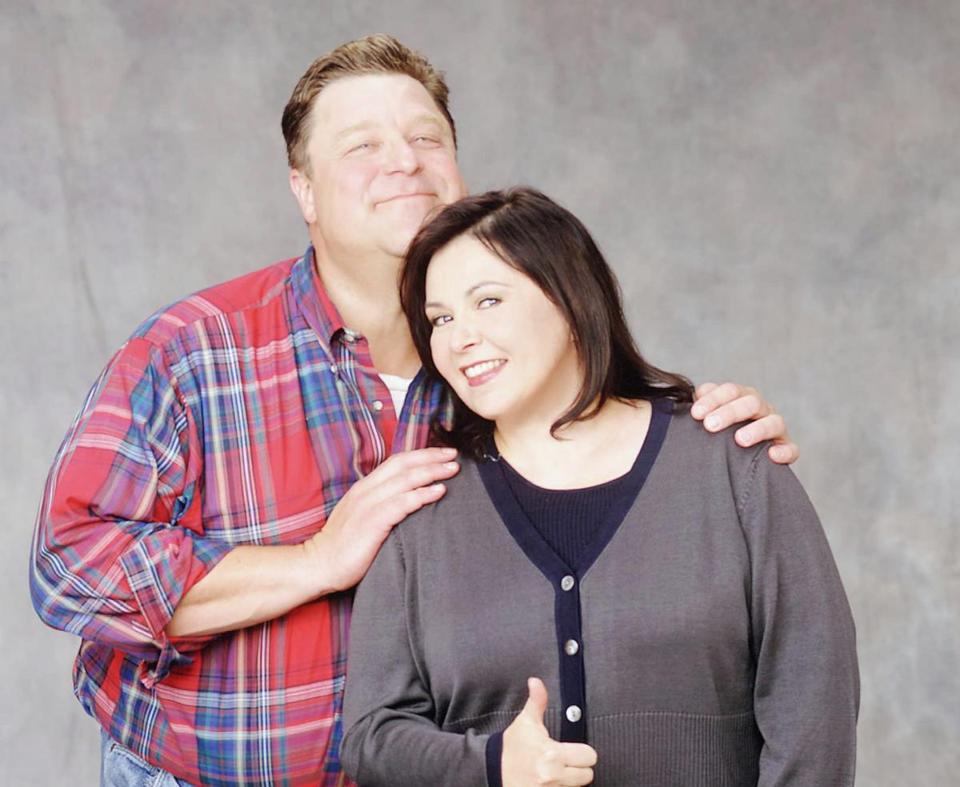 "John Goodman and Roseanne Barr in ""Roseanne."""
