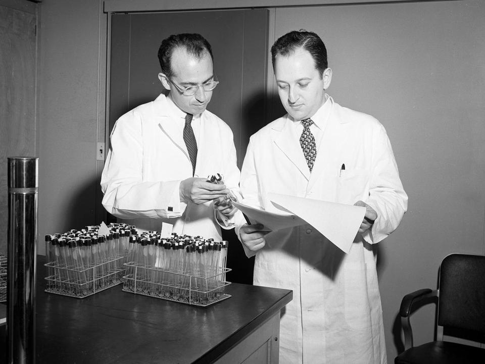 Dr. Youngner (right) was an aide on a research team assembled by Dr. Jonas Salk (left).