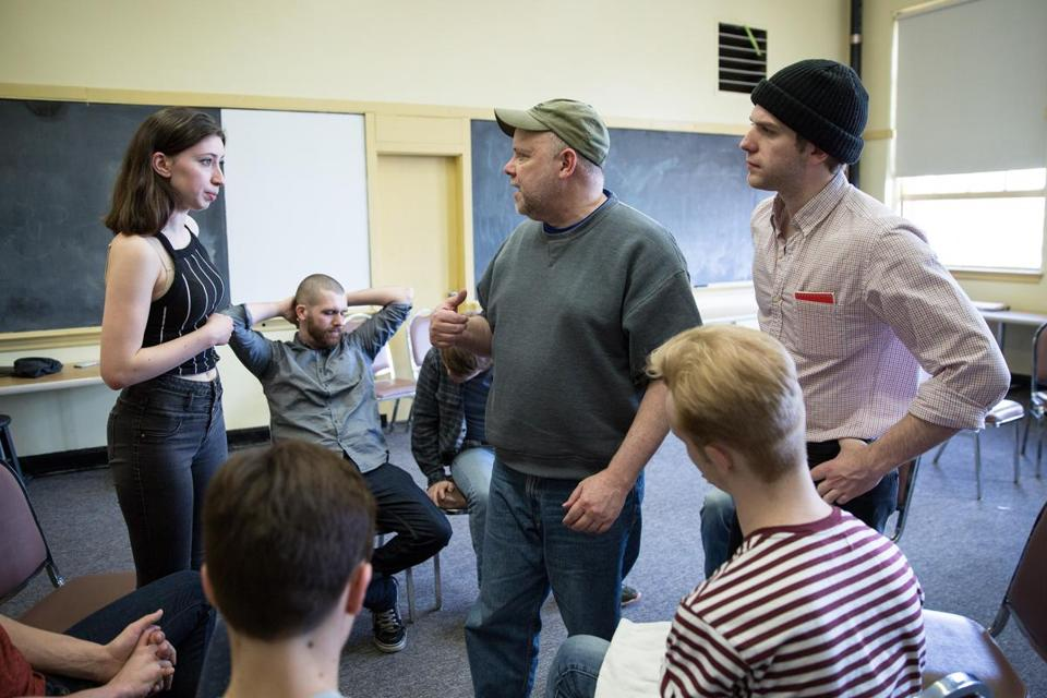 "04/08/17 -- Boston, MA -- Director Burgess Clark (center) instructs Teresa Gelsomini, 18, playing Nurse Ratched (left), and Sam Mulcahy, 21, playing Randle McMurphy, as they run through a scene during rehearsal of Boston Children's Theatre production of ""One Flew Over the Cuckoo's Nest"", on April 8, 2017, in Boston, Massachusetts. (Kayana Szymczak for The Boston Globe)"
