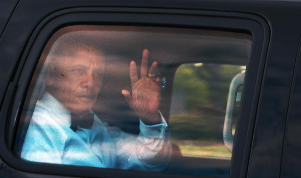"Boston, MA May 4, 2017: People were gathered at the entrance to the UMASS Boston campus on Morrissey Boulevard as they waited for the arrival of former president Barack Obama, who was heading for the JFK Library to accept the ""Profiles in Courage Award"". Obama is pictured as he waves to the people from inside his car while driving by. (Globe Staff Photo/Jim Davis)"