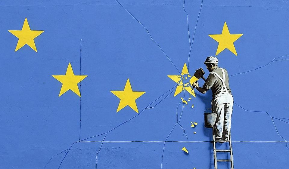 epa05950992 A close-up view of the Brexit-inspired mural by Banksy, showing a worker chipping away at a star on a EU flag, that has been painted on the side of a building in Dover, Britain, 08 May 2017. The artwork emerged overnight under Dover Castle near the ferry terminal, which connects the UK with mainland Europe. The mural, which was confirmed by Banksy's representatives to be a genuine work by the British street artist, is his first comment on the Brexit vote last year. EPA/GERRY PENNY