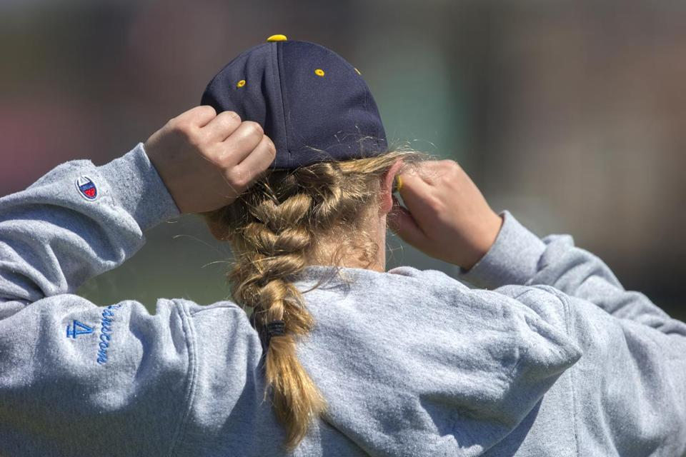 The ponytail is a giveaway that this ballplayer is a girl.
