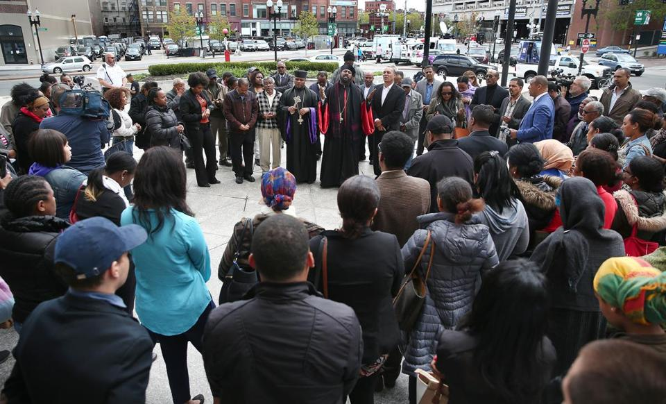 Boston, MA - 5/10/2017 - Supporters gather outside after the arraignment. Malone Kidanemariam (cq), of Boston, is arraigned in Boston Municipal Court for the hit-and-run death of bicyclist Rick Archer (cq), 29. A large group of family and supporters were at the Edward W. Brooke Courthouse for the 25-year-old, who was ordered held on $25,000 bail. Photo by Pat Greenhouse/Globe Staff Topic: 11arraignKidanemariam Reporter: Andrew Rosen