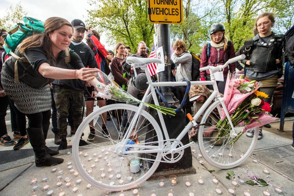 05/10/2017 BOSTON, MA Attendees lit candles around a Ghost Bike placed at the intersection of Clarendon and Commonwealth in Boston in memory of Rick Archer (cq). Archer was a bicyclist killed at the intersection. (Aram Boghosian for The Boston Globe)