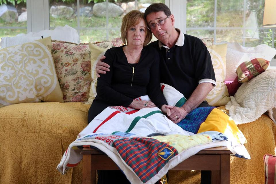 Carol and Warren Chesley with a memory quilt honoring their son, Jason. They won a change in procedure after Jason's death at Arbour Hospital in Jamaica Plain in 2002. They were incensed to hear of a similar death in Pembroke in 2015.