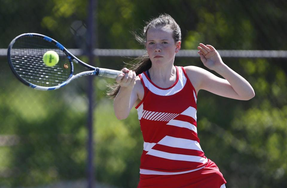 Hingham, MA -- 5/16/2017 - Hingham girl's tennis player Lexi Dewire warms up before her match against Lexington. (Jessica Rinaldi/Globe Staff) Topic: 21sotennis Reporter: