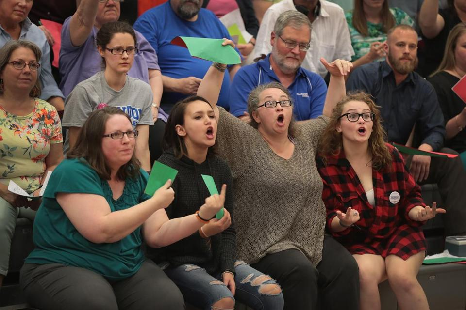 CEDAR RAPIDS, IA - MAY 09: Guests react to a statement by U.S. Rep. Rod Blum (R-IA) during a town hall meeting on May 9, 2017 in Cedar Rapids, Iowa. The meeting is the second of four town hall meetings Blum has scheduled in his district this week. About 1,000 people attended the event. (Photo by Scott Olson/Getty Images) *** BESTPIX ***