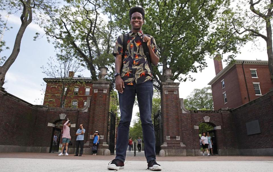 Obasi Shaw posed outside the gates of Harvard Yard in Cambridge.