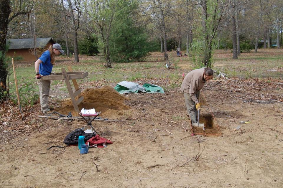 Jill Zuckerman (left) and Alexander Honsinger (right) removed layers of topsoil.