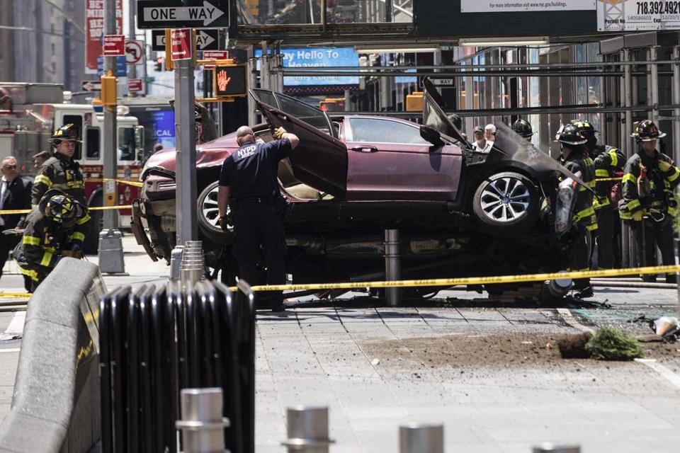 New York, NY - 5/18/2017 - Emergency workers investigate the scene of a car that crashed into pedestrians in Times Square New York, NY, May 18, 2017. (Keith Bedford/Globe Staff)