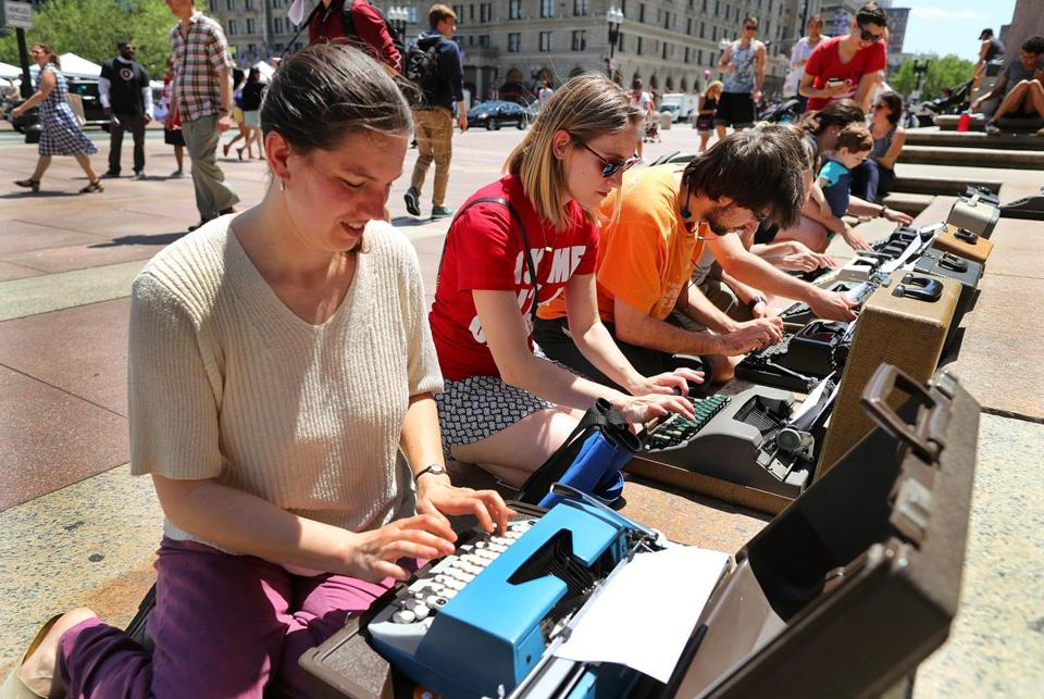 "Zoe Sherman (above), Mahiti Bapuji (left) took part in the ""Write-In"" in Copley Square Friday. The event, inspired by the sit-ins of the civil rights movement, started slowly enough before the sight of some kneeling before eight typewriters lured others."