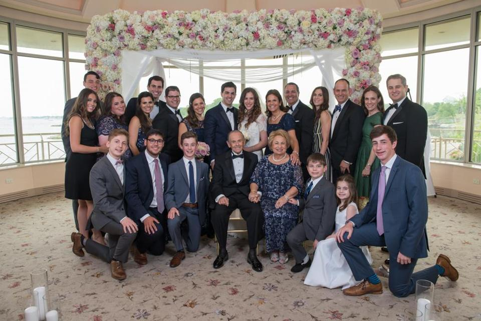 Ruth and Andrew Burian surrounded by their children and grandchildren (with spouses) at their grandson's Kenny's wedding.