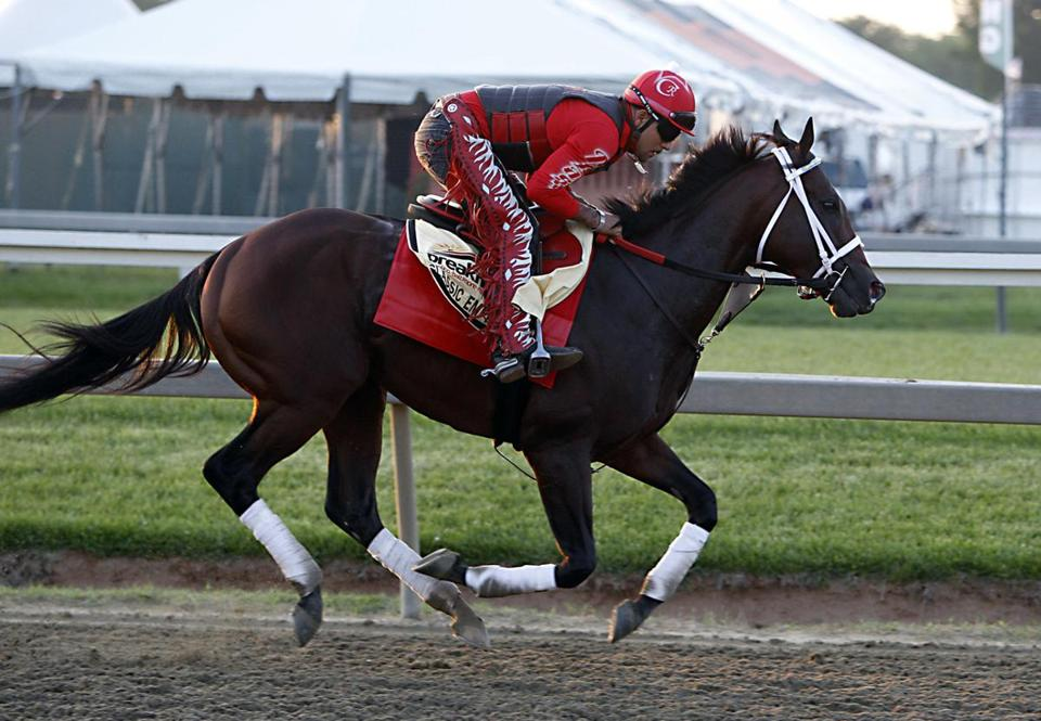 Exercise rider Martin Rivera gallops Preakness Stakes entrant Classic Empire at Pimlico Race Course in Baltimore, Friday, May 19, 2017. (AP Photo/Garry Jones)